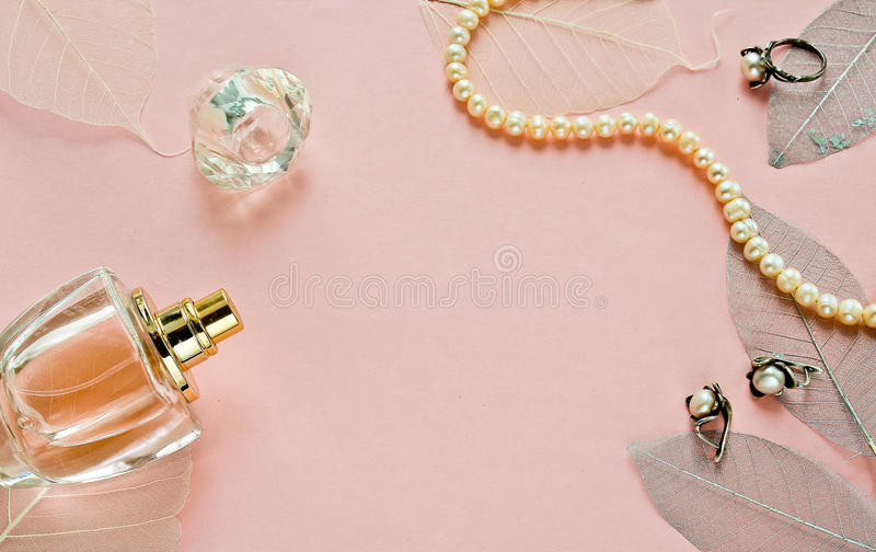 Pink background with bottle perfume stock photo