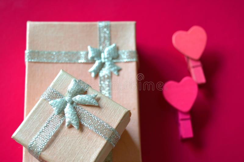 Pink gift box and hearts decorative pink background royalty free stock images
