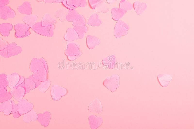 Pink background with heart-shaped confetti stock images