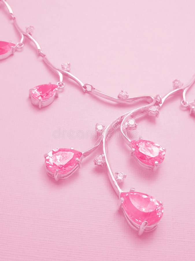 Pink background with necklace. Background for a Valentine card stock photo