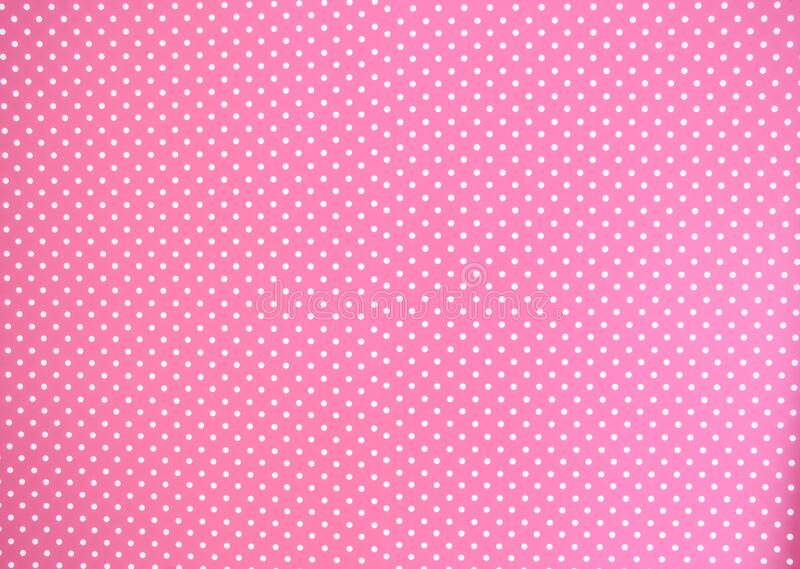 Pink background texture with white polka dots, Pink and white spot pattern can be used for background retro modern royalty free stock images