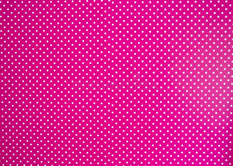 Pink background texture with white polka dots, Pink and white spot pattern can be used for background retro modern stock photography