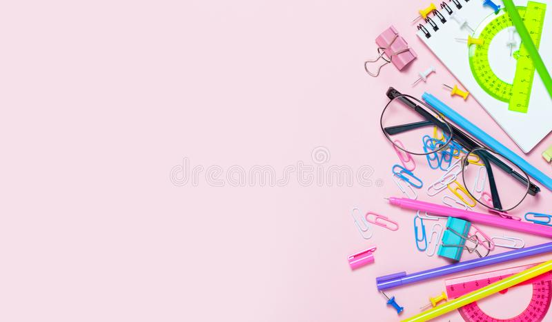Pink background with various School accessories are laid out in the form of a rainbow royalty free stock image