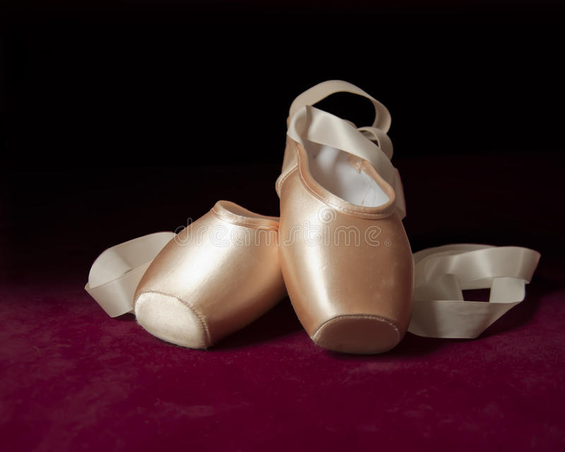 Pink ballet pointe shoes stock images
