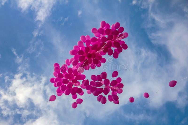 Pink balloons in a blue sky stock image