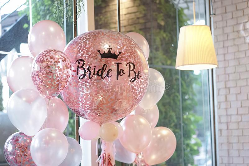 Pink balloons. Helium balloons in pink and white decoration for. The hen party with the words written as Bride to be royalty free stock photography