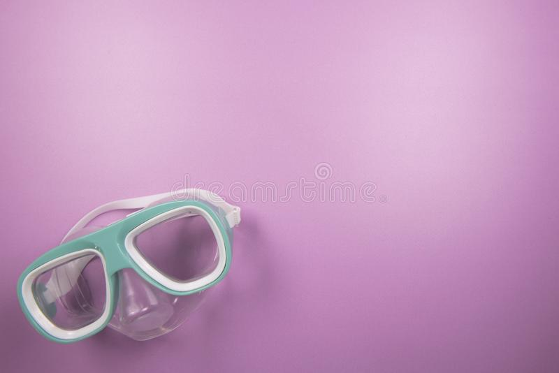 Pink beach background image of a snorkel. With copy space stock photos