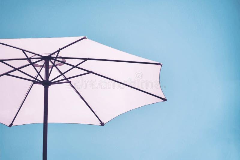 Pink Beach Umbrella. Against sunny blue sky royalty free stock photo