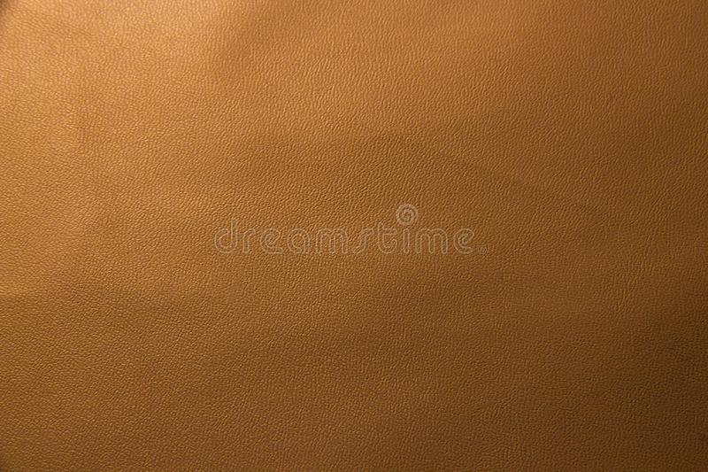 Light pink beige leather texture. Pink beige background with faux leather texture closeup royalty free stock images
