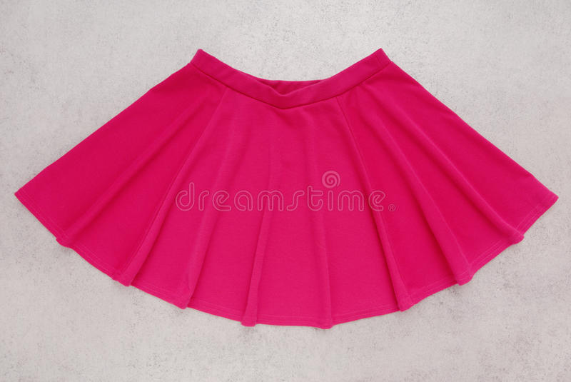 Pink bell-bottomed is , skirt has crimson colour royalty free stock photo