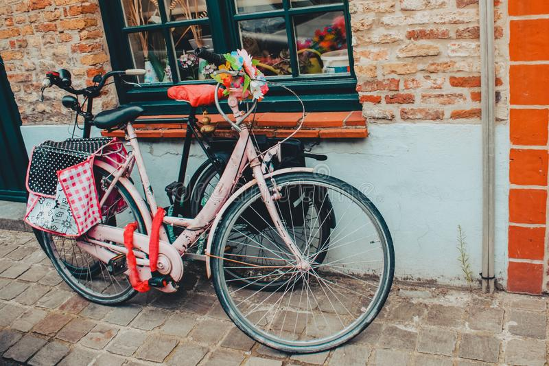 Pink bicycle and black bicycle on a street in Belgium stock image