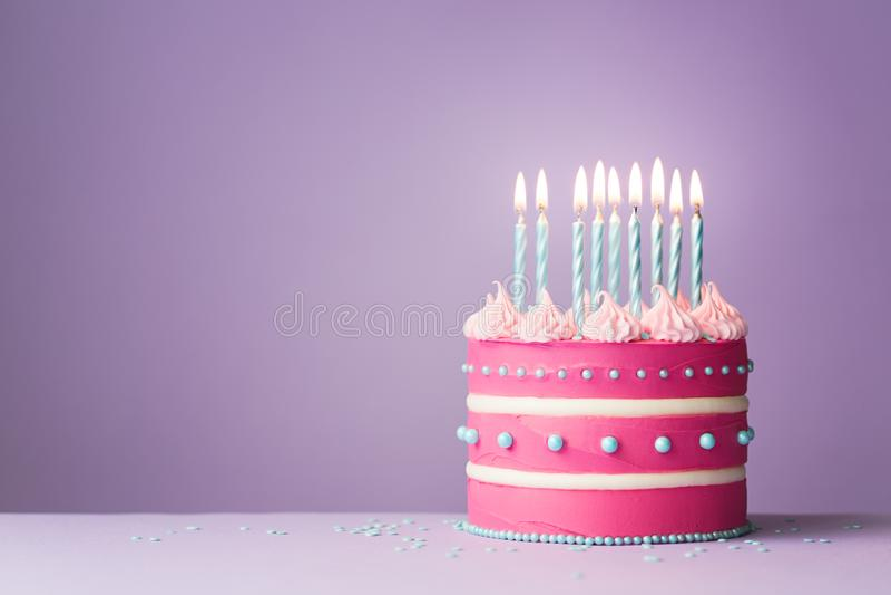 Pink birthday cake royalty free stock photography