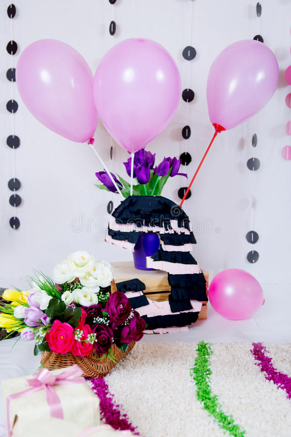 Pink and black baby birthday party decor royalty free stock photography