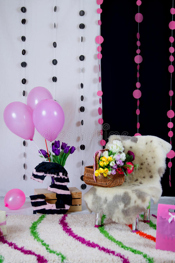 Pink and black baby birthday party decor royalty free stock photo