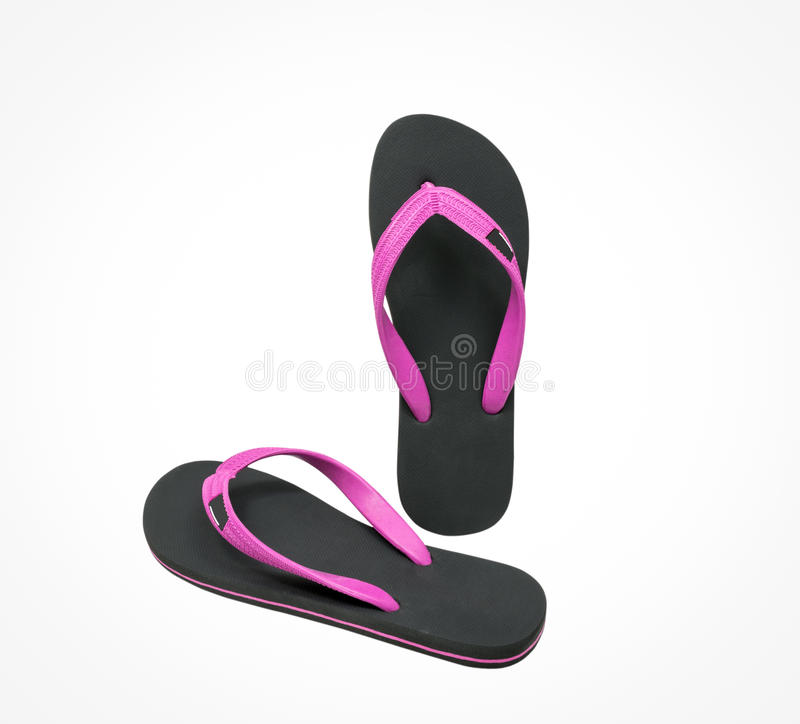 Pink and black flip flop sandals isolated stock photography
