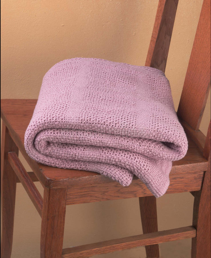 Free Pink Blanket Folded On Wooden Chair Royalty Free Stock Photos - 13455568