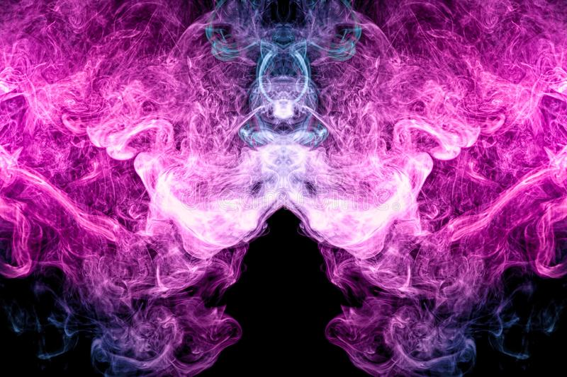 Abstract art colored blue and pink smoke on black isolated background. stock photo
