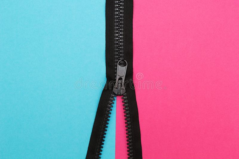Pink and blue are connected zip stock photography