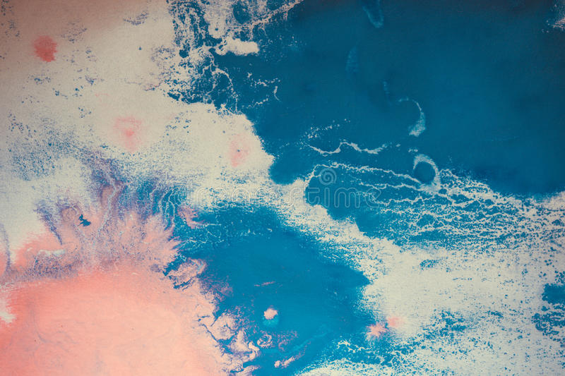 Pink and blue flowed blots on white paper stock photography