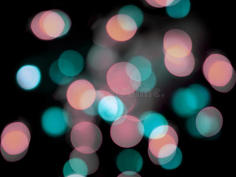pink and blue pastel colored blurred round lights night background royalty free stock photos