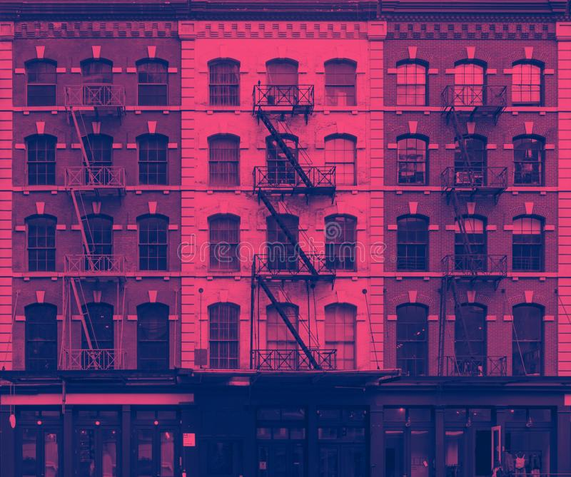 Pink and blue wall of windows on New York City buildings. NYC royalty free stock image