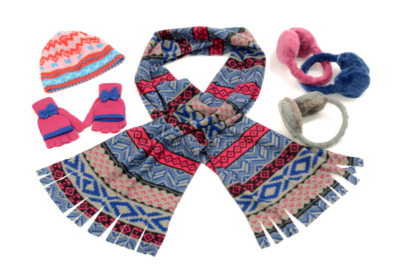 Pink and blue winter accessories isolated on white background. stock photo