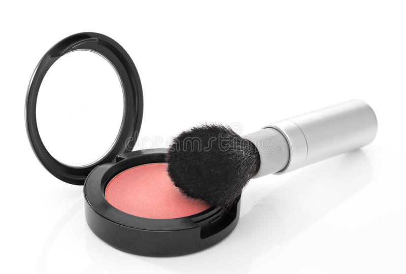 Pink blush and makeup brush on white background stock photography