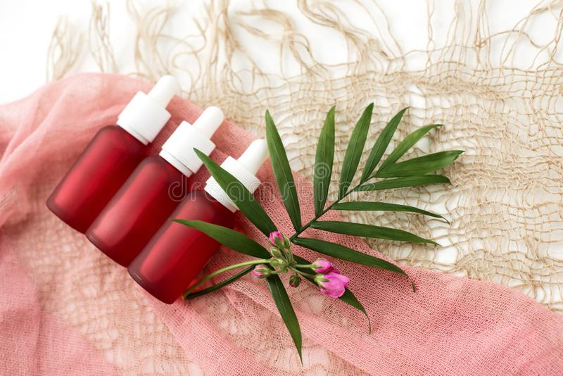 Cosmetic bottles, pink oil jars, royalty free stock photos