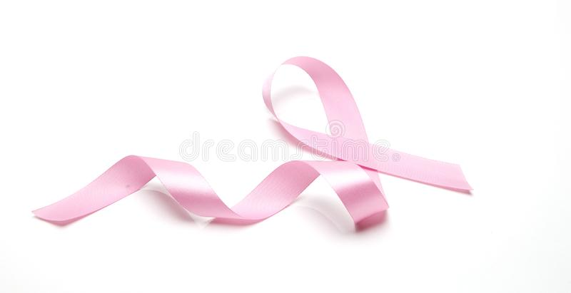 Pink breast cancer ribbon. On white background royalty free stock photography