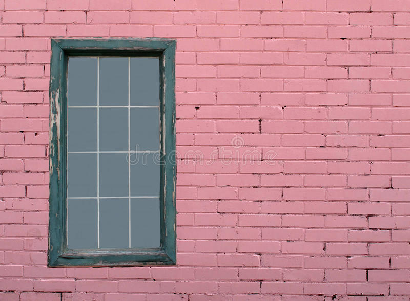 Pink brick wall and window royalty free stock images