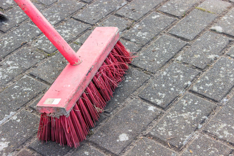 Pink broom royalty free stock photography