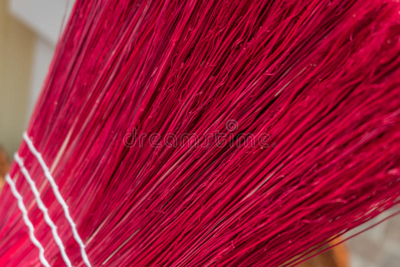 Pink broom up close royalty free stock image