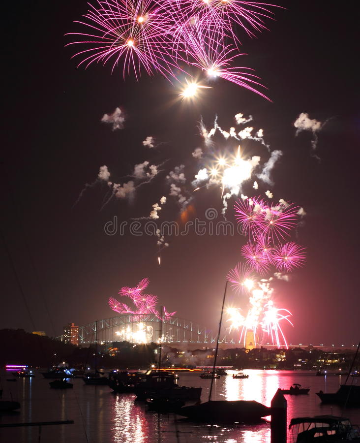 Fireworks pink butterflies over harbor scenery of Sydney stock images