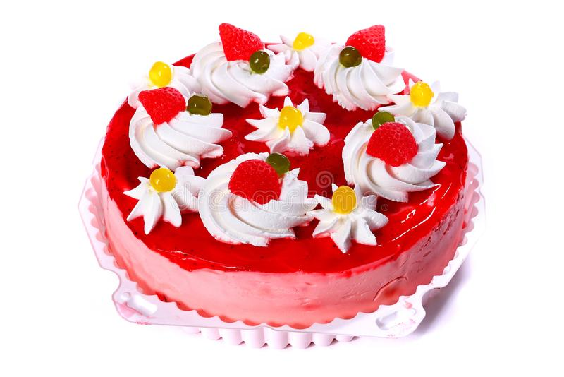 Pink cake with cream flowers. Isolated over white background royalty free stock image