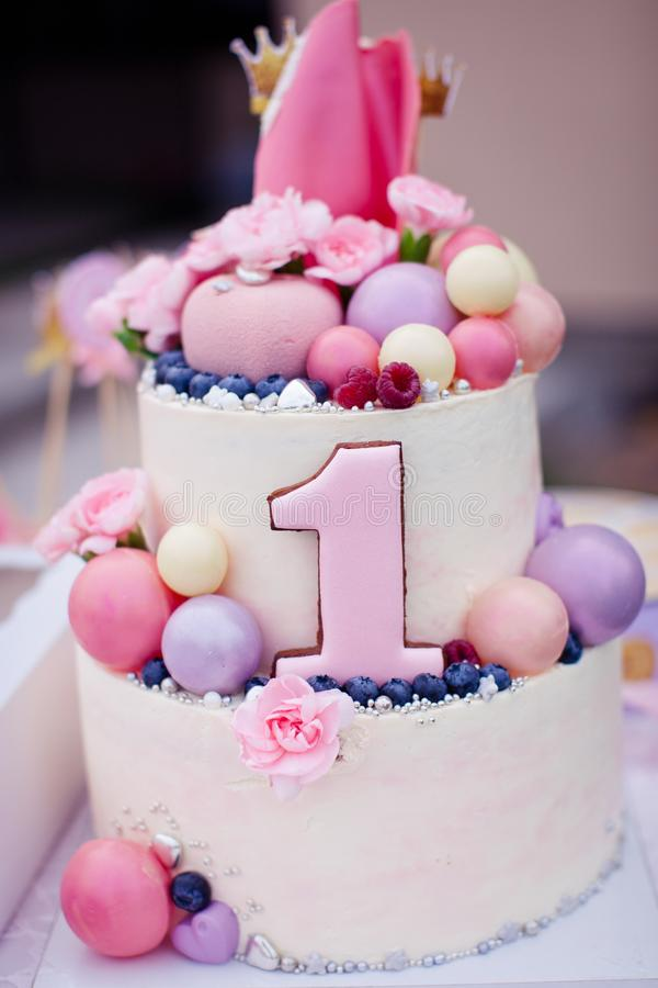 Pink cake for a girl on the birthday of one year old stock image