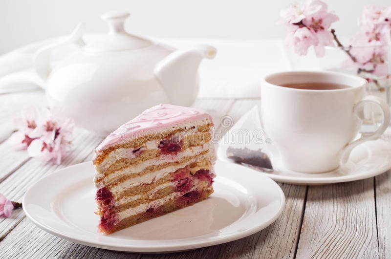 Pink cake. Still life in white key royalty free stock image