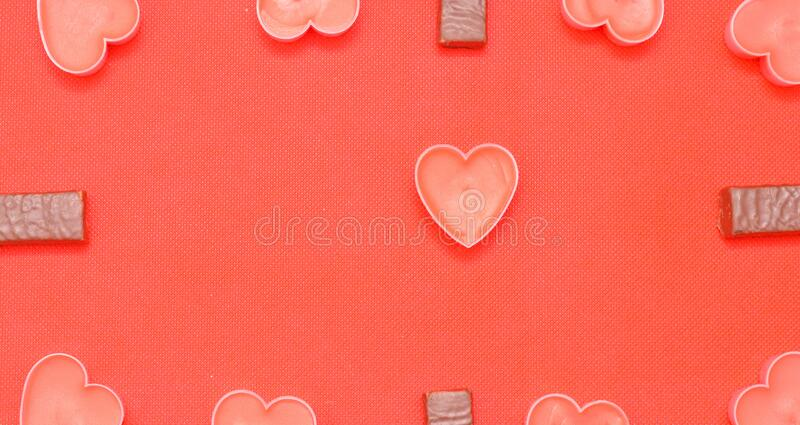 Pink Candle hearts and chocolate candies on pink background. Happy valentines day.Pink Candle hearts and chocolate candies on pink background.Romantic Valentine stock photo