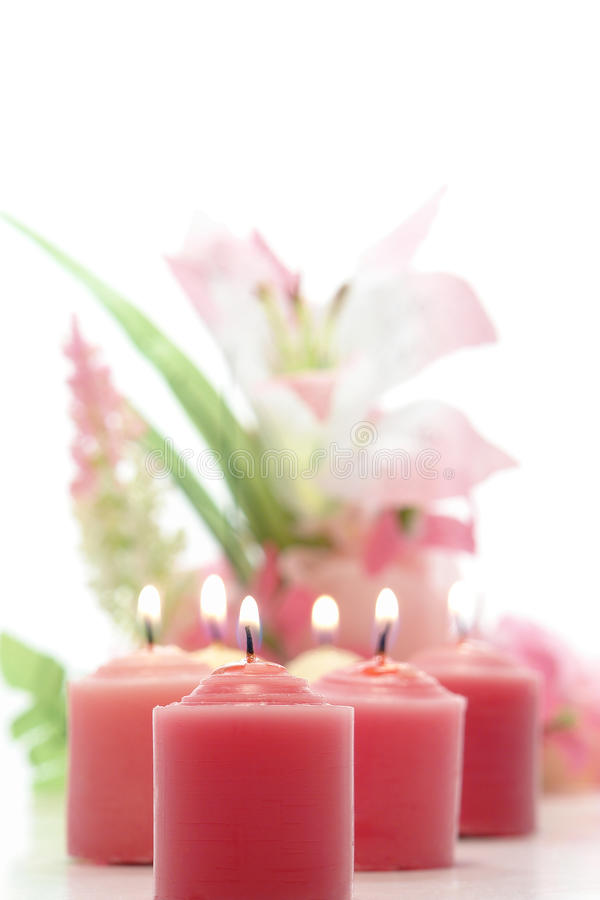 Pink Candles Burning and Pastel Floral Arrangement royalty free stock photography