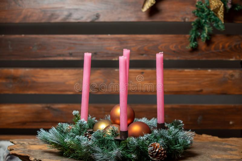 Pink candles with christmas decoration against rustic wood with generous copy space, panorama, selected focus, narrow depth of. Pink candles with christmas stock image