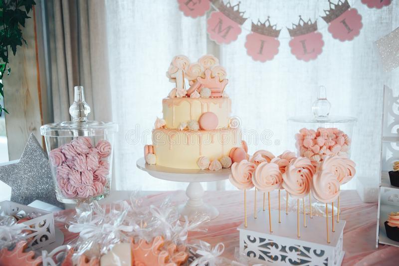 Pink candy bar for first birthday. Sweet table and big cake for first birthday royalty free stock photography