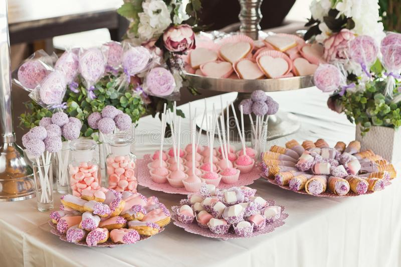 Dessert table for any holiday at wooden background royalty free stock photo