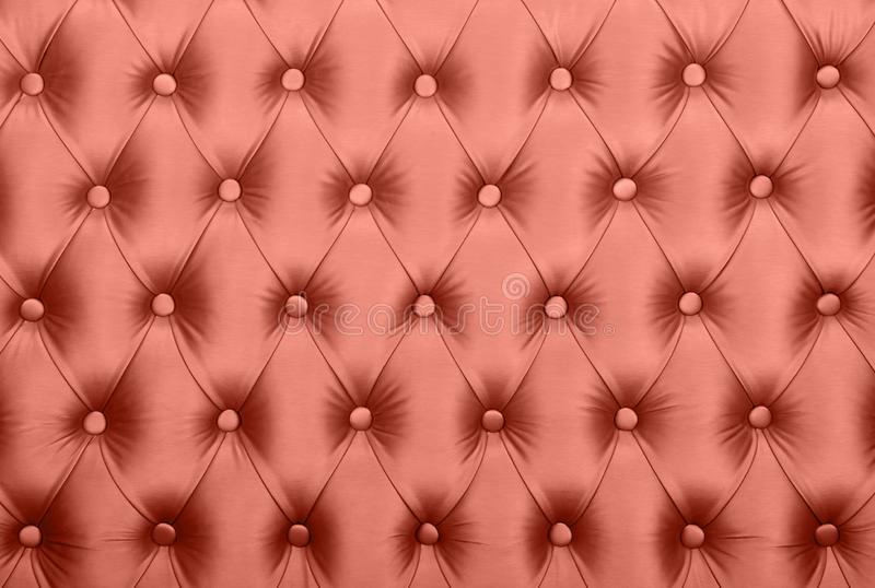 Pink capitone tufted fabric upholstery texture stock photos