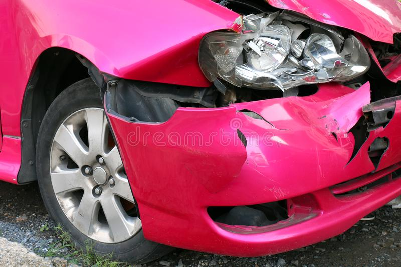 Pink car accident damaged to headlights front, broken headlights car crash accident, damaged automobiles after collision of pink stock photo