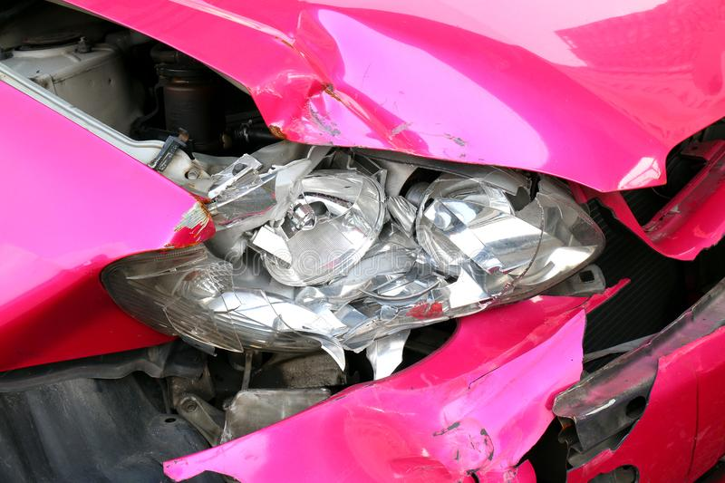 Pink car accident damaged to headlights front, broken headlights car crash accident, damaged automobiles after collision of pink c stock photos