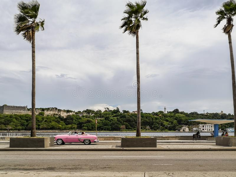 Pink car in the city stock photography