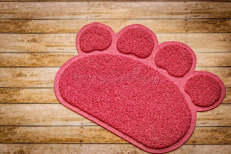 Paw-shaped pink cat litter mat background stock images