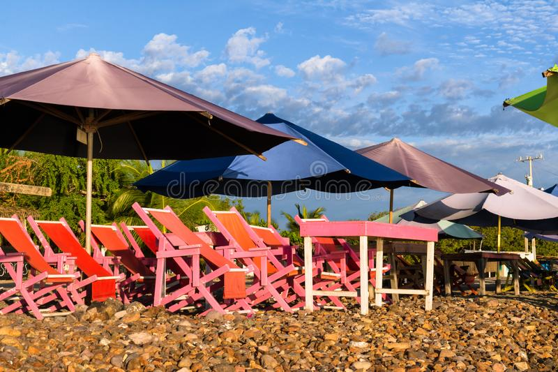 Pink chairs are on the beach. There are many colors in the beach furniture Boquita in Manzanillo Colima Mexico royalty free stock photo