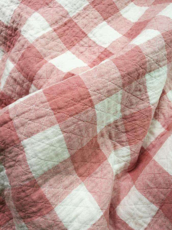 Pink checkered cotton blanket royalty free stock photos
