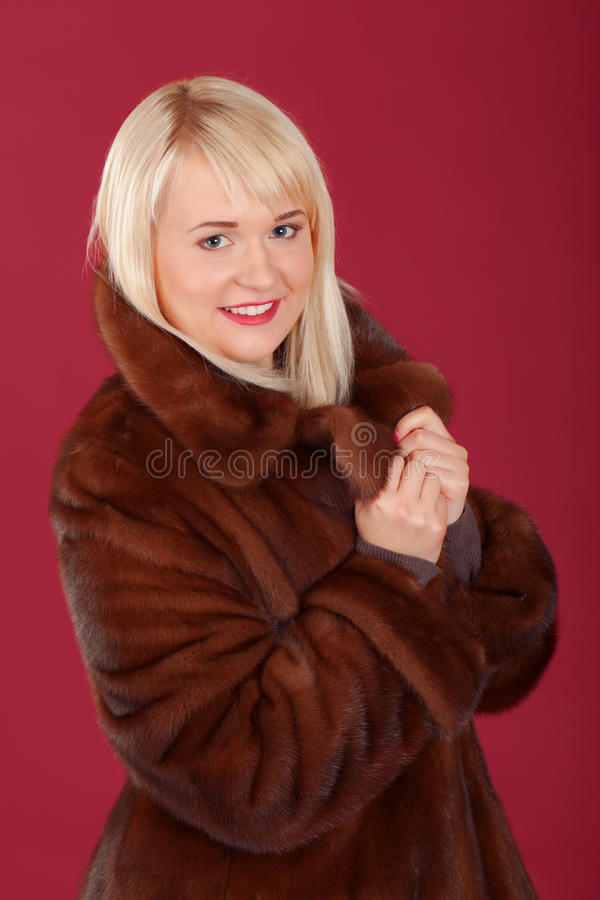 Pink chic. Girl in winter coat on pink background royalty free stock photos