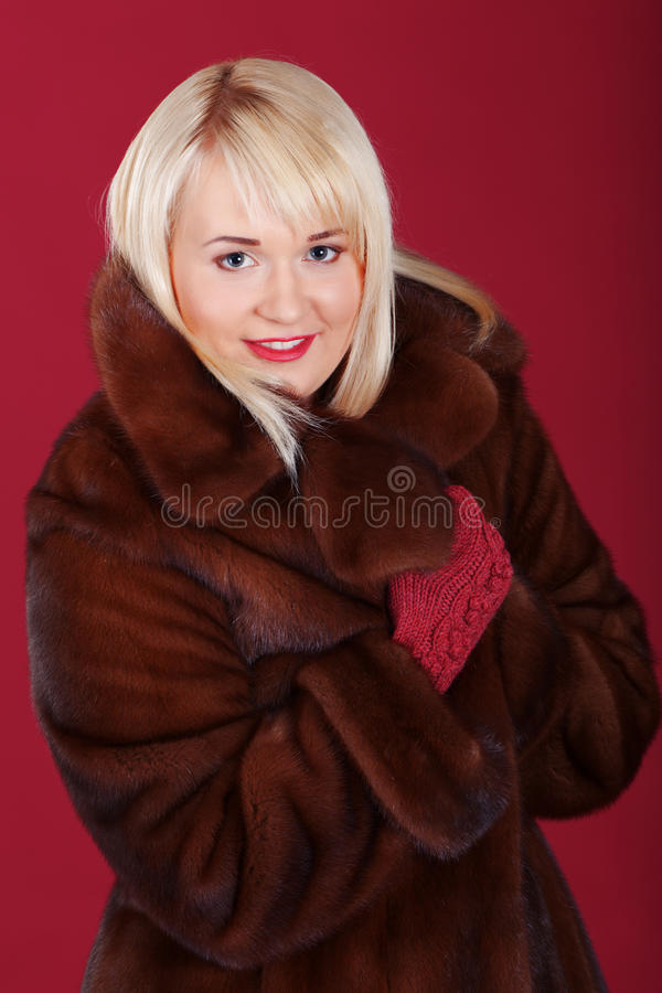 Pink chic. Girl in winter coat on pink background stock images